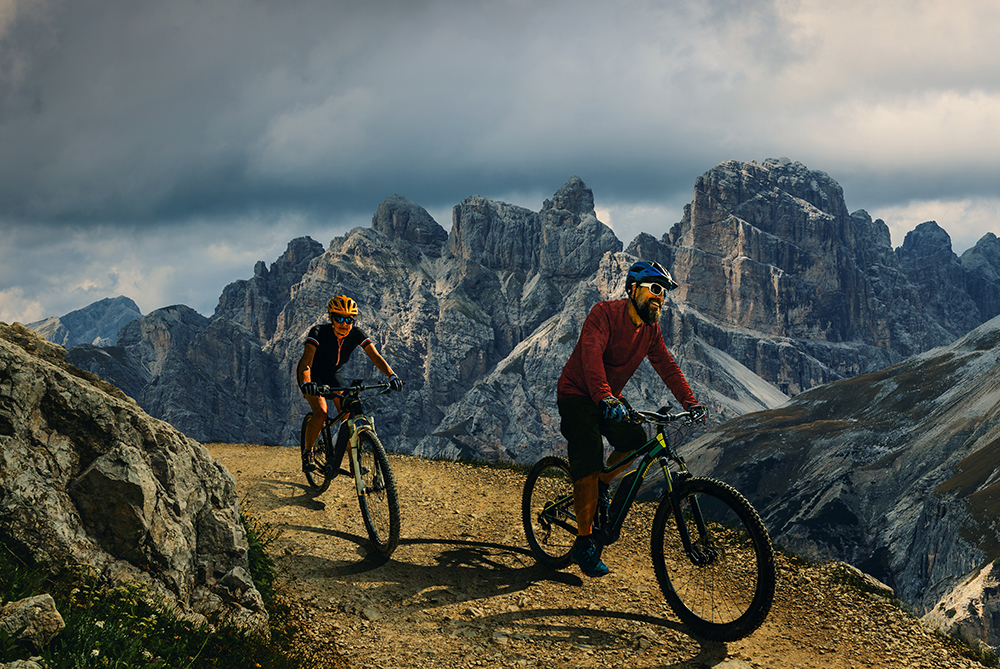 Cycling Outdoor Adventure In Dolomites. Cycling Woman And Man O
